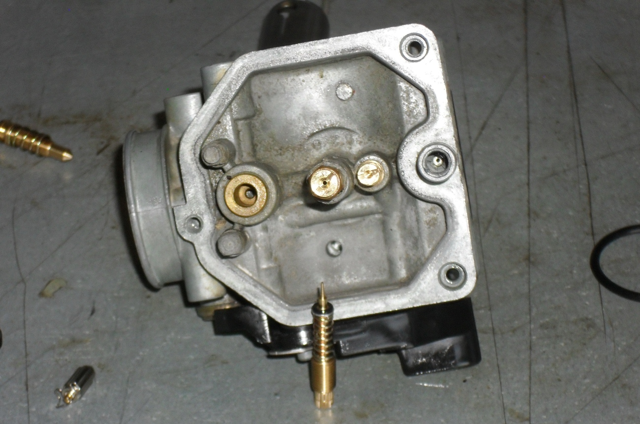Yamaha Part With A Wire That Goes Up By Carburetors